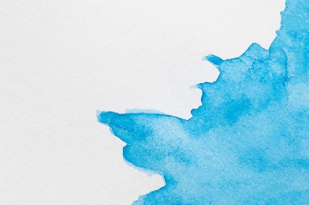 Vagues d'encre abstraites de couleur sur la surface blanche Photo gratuit