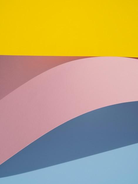 Vagues de formes abstraites en papier avec une ombre Photo gratuit