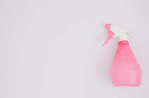 Vaporisateur rose sur fond blanc Photo gratuit