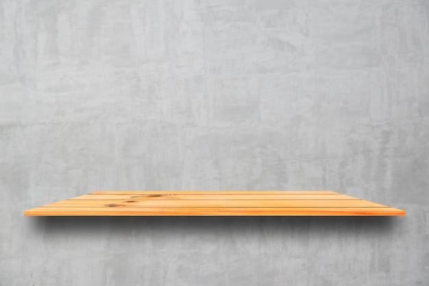 Vide les étagères en bois et fond de mur en pierre. étagères en bois marron perspective sur fond de mur en pierre Photo gratuit
