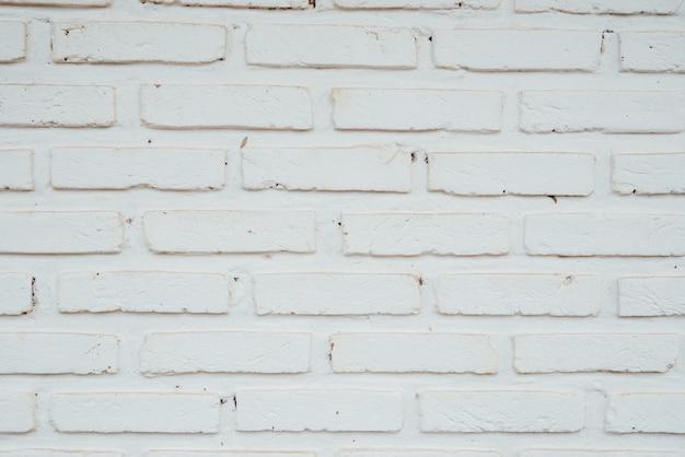 La vieille texture de brique avec des fissures peut être utilisée comme arrière-plan Photo gratuit