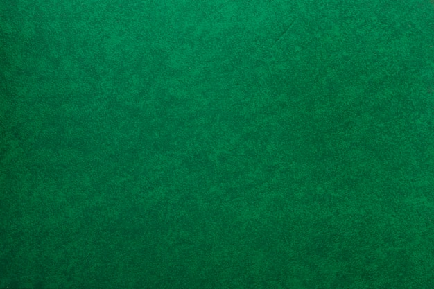 Un vieux fond de papier vert texturé Photo gratuit