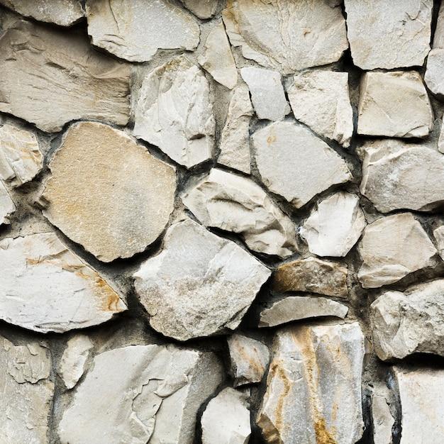 Vieux fond de texture de mur en pierre gros rochers Photo gratuit