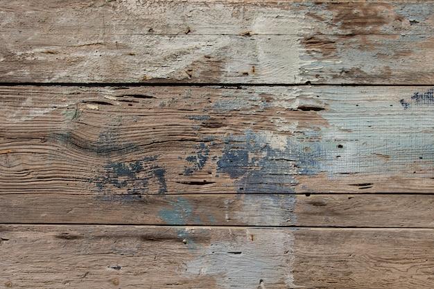 Vieux modèle en bois horizontal rugueux avec des traces de peinture, arrière-plans de textures bois Photo Premium