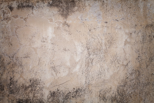 Vieux mur beige recouvert de plâtre inégal. texture de fond de surface vintage brique de sable minable Photo Premium