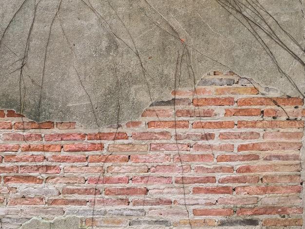 Vieux mur de briques dans l'antiquité et a été endommagé Photo Premium