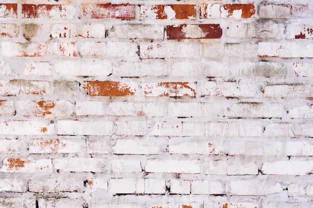 Vieux mur de briques rouges vintage avec texture de joints de ciment Photo Premium