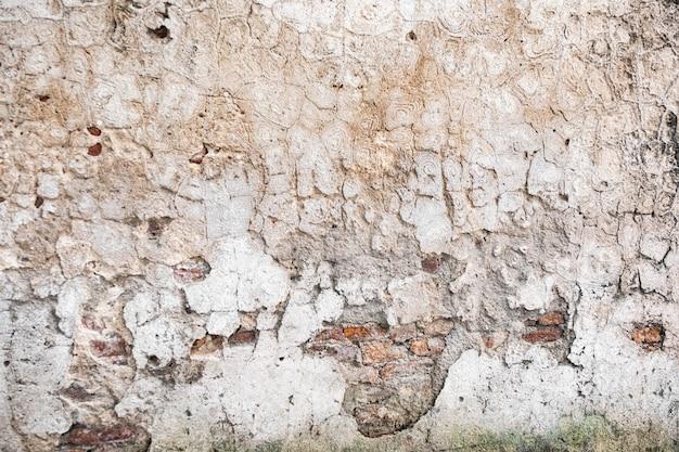 Vieux mur de briques avec texture fissures Photo Premium