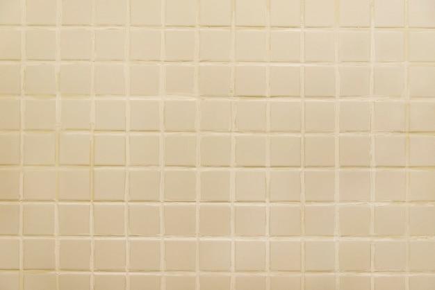 Vieux mur de carrelage beige Photo Premium
