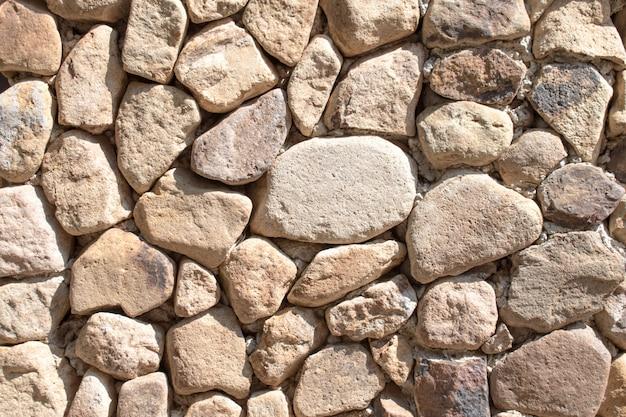 Vieux mur de pierre aménagé à fond Photo Premium