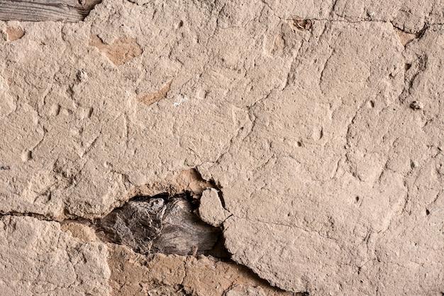 Vieux mur en torchis avec surface fissurée Photo Premium