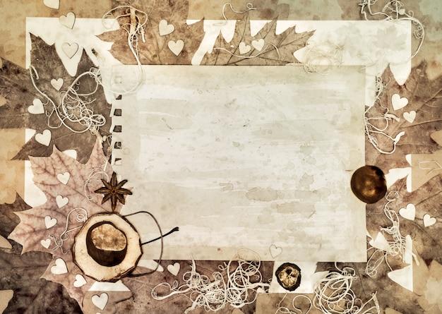 Vieux papier avec feuilles d'automne Photo Premium