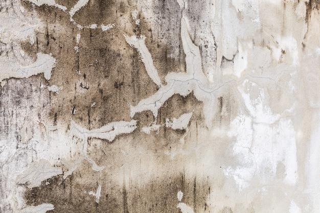 Vieux texturé peint blanc fané patiné texture sur fond de surface de mur de béton de ciment fissuré Photo Premium