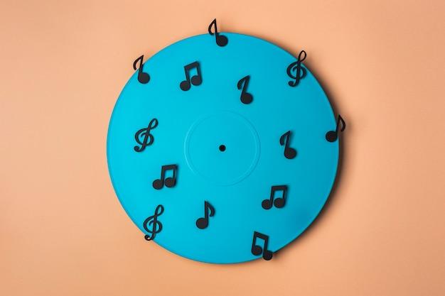 Vinyle Bleu Avec Des Notes De Musique Photo gratuit