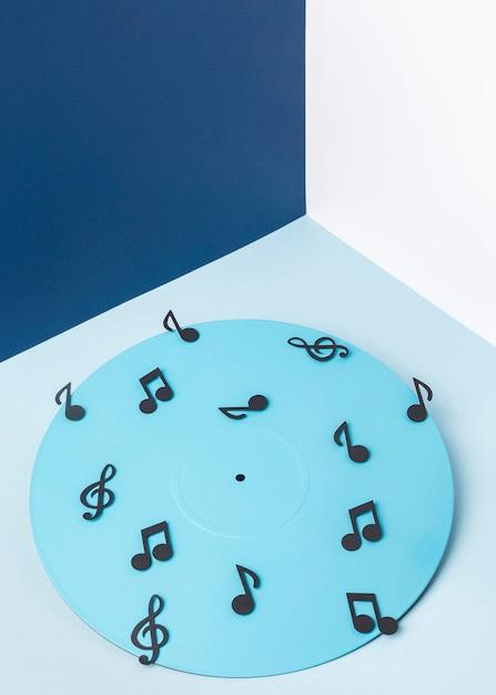 Vinyle Bleu Avec Des Notes De Musique Photo Premium