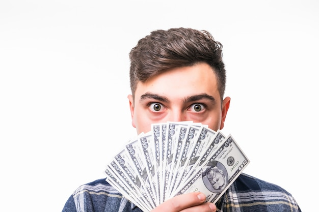 Visage De Jeune Homme Riche Couvert De Fan D'argent Photo gratuit