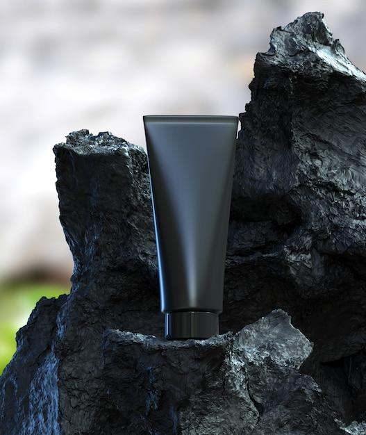 Volcanic Mud Skincare Soin Du Visage Cicatrisation Profonde Nettoyer Le Traitement De Beauté Avec Un Emballage En Tube De Plastique Noir Sur Pierre Noire Photo Premium