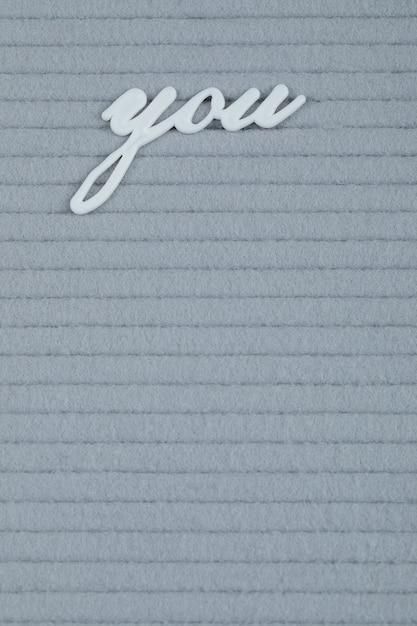Votre Phrase Incrustée Sur Un Tissu Gris Photo gratuit