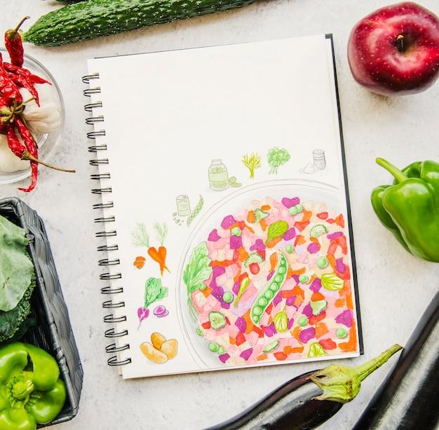 Vue aérienne d'un livre de légumes et de recettes Photo gratuit