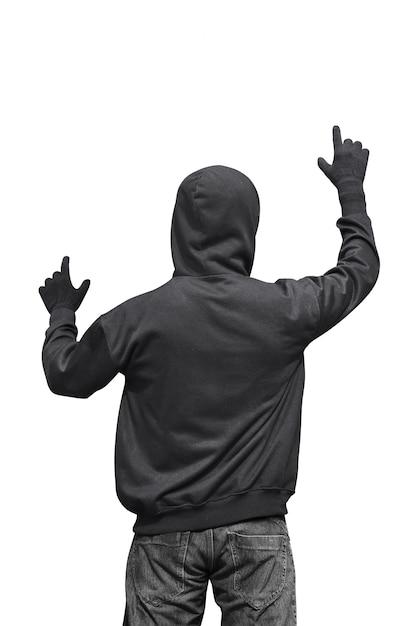 Vue arrière du pirate à capuchon touchant quelque chose Photo Premium