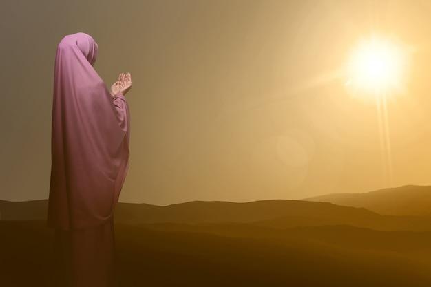 Vue arrière d'une femme musulmane asiatique priant dieu Photo Premium