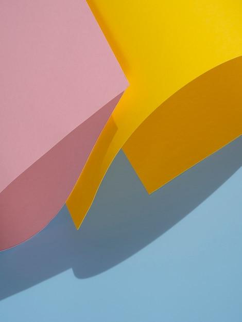 Vue de dessus abstrait des formes de papier avec une ombre Photo gratuit