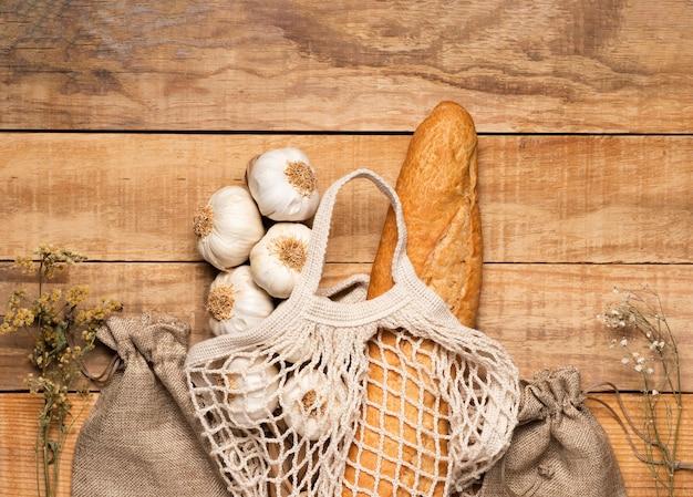 Vue de dessus des aliments sains et des graines sur fond en bois Photo gratuit