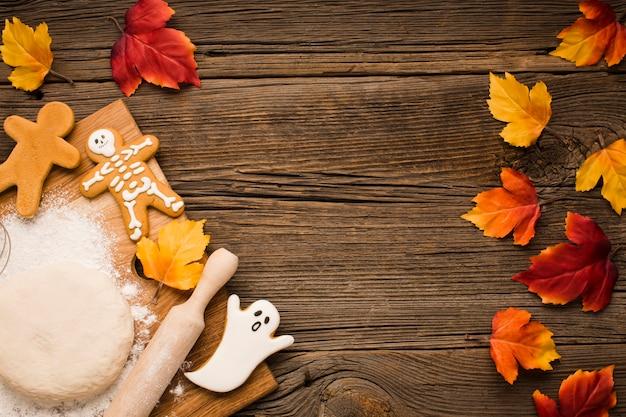 Vue de dessus des biscuits d'halloween avec de la pâte Photo gratuit