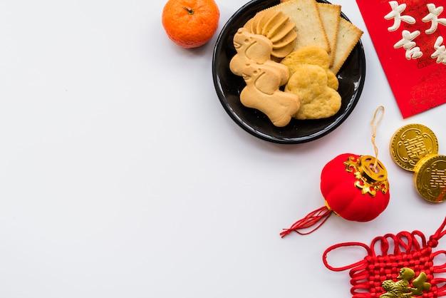 Vue de dessus composition du nouvel an chinois avec fond Photo gratuit