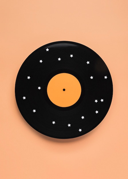 Vue De Dessus De La Composition De Vinyle Noir Avec Des étoiles Blanches Photo gratuit