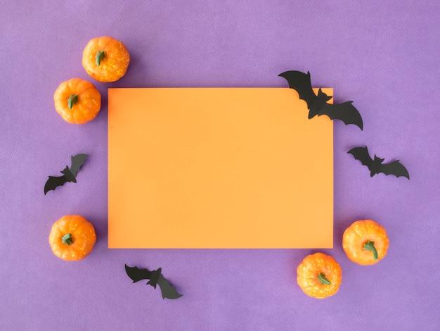 Vue De Dessus Concept Halloween Avec Des Citrouilles Et Des Chauves-souris Photo gratuit