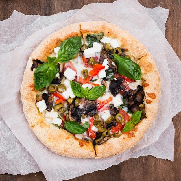 Vue De Dessus Délicieuse Pizza Au Four Photo gratuit