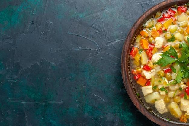 Vue De Dessus Délicieuse Soupe Aux Légumes Avec Différents Ingrédients à L'intérieur Du Pot Brun Sur Le Bureau Sombre Soupe Légumes Sauce Repas Nourriture Chaude Photo gratuit