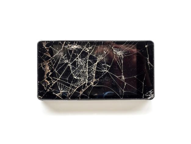 Vue de dessus du téléphone intelligent à écran tactile cassé isolé sur fond blanc Photo Premium