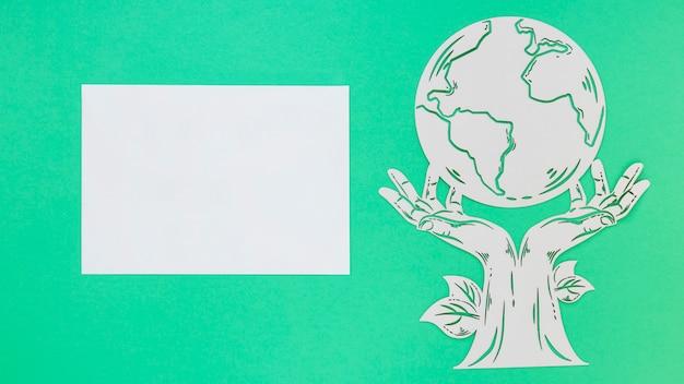 Vue De Dessus Objet En Bois De La Journée Mondiale De L'environnement Sur Fond Vert Photo gratuit
