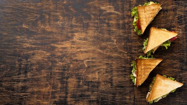 Vue De Dessus Des Sandwichs Triangle Avec Espace Copie Photo gratuit