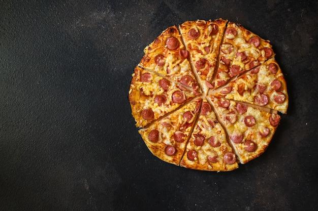 Vue de dessus de savoureuse pizza Photo Premium