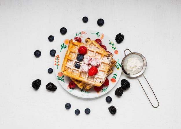 Vue De Dessus Savoureux Petit Déjeuner De Gaufres Photo gratuit