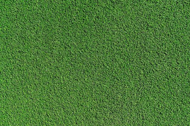 Vue De Dessus De La Texture D'arrière-plan Du Terrain De Football En Gazon Synthétique Photo gratuit