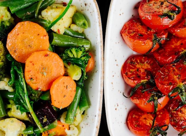 Vue De Dessus Tomates Séchées Au Soleil Avec Légumes Compotés Asperges Carottes Au Brocoli Photo gratuit