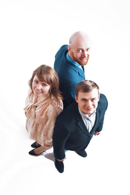 Vue de dessus: trois personnes dos à dos. hommes et femmes en costume Photo Premium