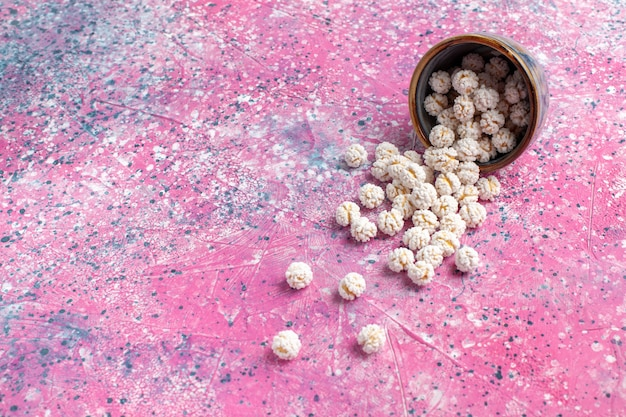 Vue De Face Confitures Sucrées Blanches Sur La Surface Rose Photo gratuit