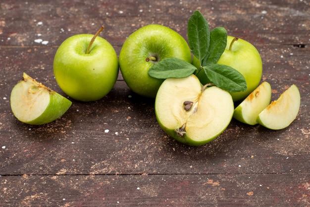 Une Vue De Face Pomme Verte Fraîche Aigre Et Moelleuse Sur Le Fond Sombre Couleur Des Fruits En Bonne Santé Photo gratuit