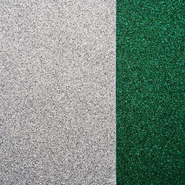 Vue grand angle de tapis vert et gris Photo gratuit