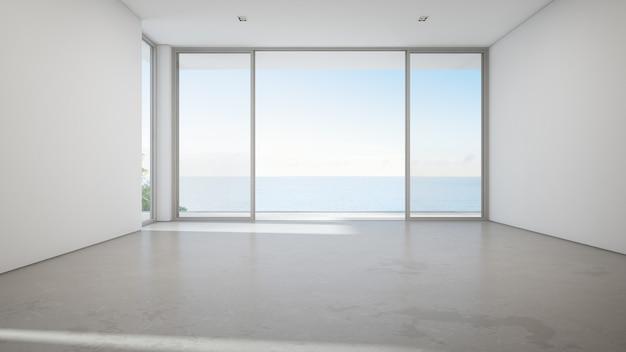 Vue sur la mer grand salon de la maison de plage d'été de luxe avec grande porte vitrée et sol en béton vide. Photo Premium