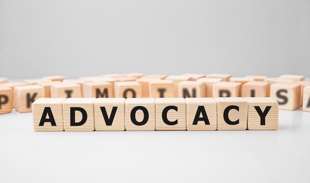 Word Advocacy Fait Avec Des Blocs De Construction En Bois Photo Premium