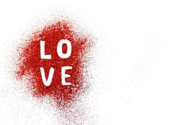 Word love sur le sable coloré Photo gratuit