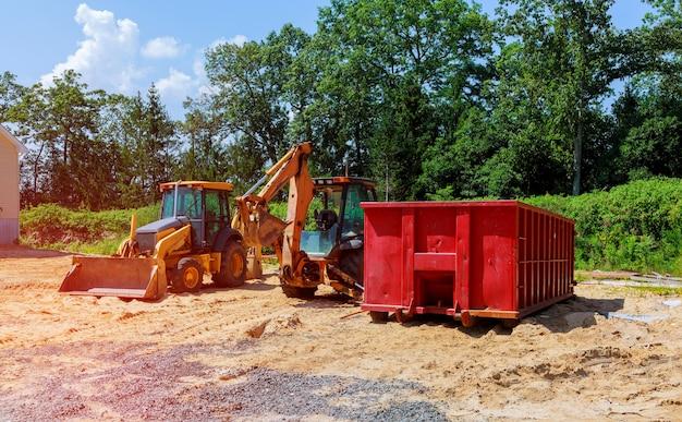 Yellow excavator nouvelle construction tracteur excavateurs et poubelles Photo Premium