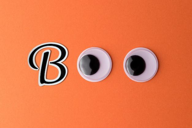 Yeux écarquillés Sur Fond Orange Photo Premium