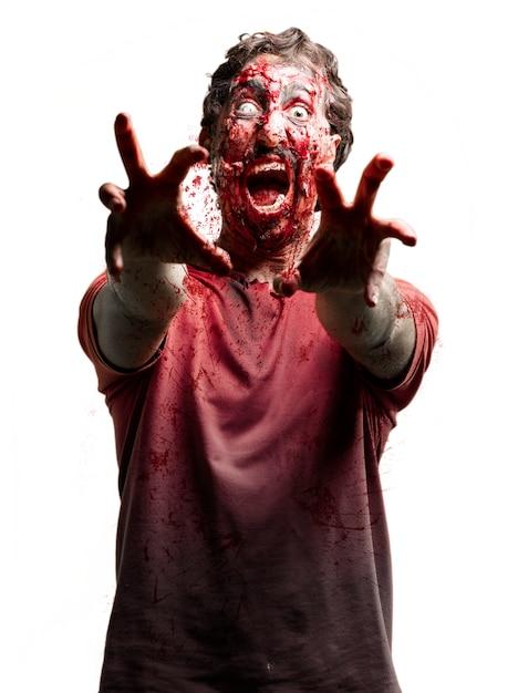 Zombie avec un oeil blanc Photo gratuit
